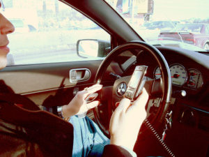 640px-Hand_held_phone_in_car