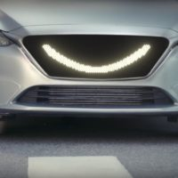 This self-driving car smiles at pedestrians