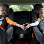 Modern child seats are bulky, and there are few sedans that can accommodate two adults, two kids in child seats, a stroller, a diaper bag, and all the other supplies needed for a crosstown jaunt.