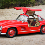 """Its gullwing doors are among the most iconic design elements in automotive history, but they're only a small part of why the 300SL is a legend. Spawned from the Le Mans–winning W194 race cars, it carried on its legacy by becoming the fastest production car in the world when it was released in the mid-1950s. We called it """"sensational"""" in our April 1956 review. Only 1400 of the distinctive coupes were built, and this one stands out from the small crowd as one of few that have not been restored. Other Gullwings might be nicer, but original parts and single-family ownership breed desire. The plaid seating is just an extra perk in the package. —Tony Markovich"""