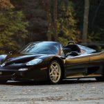 """Two arguments work against the Ferrari F50, including this ultra-rare black example. When we tested one in 1997, the F50 failed to blow away the 1988 F40 by any measure. Then there's the styling, which Ferrari itself admits has no """"raw beauty."""" But while we've seen ugly Ferraris and we've driven slow Ferraris, the F50 is neither. Built to celebrate the company's 50th anniversary, the F50 applied Ferrari's Formula 1 experience to the road. A 513-hp 4.7-liter V-8 bolted directly to a carbon-fiber monocoque was also the load-bearing support for the six-speed manual transmission and the pushrod suspension, a setup derived from the F1 race cars. Out of 349 cars built between 1995 and 1997, 55 were originally imported to the U.S., and this 2083-mile F50 is currently the only black one here (two more are overseas). Without ABS or any power assists, the bare-bones F50 did include a pair of driver's shoes, luggage, and both a canvas top and a fixed hardtop. And even if it's not red, the F50 is perfect to our eyes. —Clifford Atiyeh"""