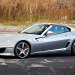 """Automakers often use birthdays and anniversaries as milestones to drop limited-edition vehicles, and the 2011 Ferrari SA Aperta did just that when it launched in 2010. It was the 80th birthday of Ferrari's favorite design firm, Pininfarina, and as a wink, only 80 copies of the 599-based SA Aperta were built. SA signifies Sergio and Andrea Pininfarina, and Aperta means """"open"""" in Italian. This example is loaded with features, including the $ 50,000 carbon-fiber roof panel, and has only 2498 miles. According to Gooding, the Grigio Titanio and Nero color combination is quite possibly the only one in the world. The car is only six years old, but it sold for more than three times original list price. —Tony Markovich"""