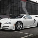 The Bugatti Veyron, even among its many special editions, hasn't truly appreciated in value. Like this 2013 example, they trade at list price or close to it, depending on the original buyer's exchange rate. The Super Sport's 8.0-liter W-16 used bigger quad turbos, two more fuel pumps, and NACA ducts to achieve a reliable 1200 horsepower. While Bugatti set a production-car record of 268 mph, it limited roadgoing Super Sports to 257, or 4 mph higher than a regular Veyron's top speed. It also built 48 in total, 18 more than it had originally said it would in 2010. Just eight Super Sport models were sold in the U.S., and Bugatti put on most of this car's 400 miles during normal factory testing. Even so, it's been serviced at least three times. With such flat prices, why not daily-drive any Veyron? Ah, that's right—a set of tires costs $ 30,000 to $ 40,000. —Clifford Atiyeh